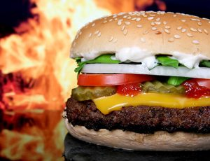 hamburger in front of flame